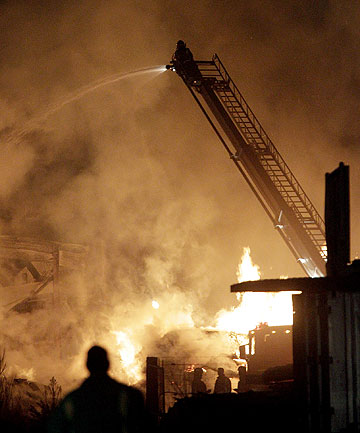 FOXTON BLAZE: A storage shed at Foxton Sawmilling Company has been completely engulfed in flames.