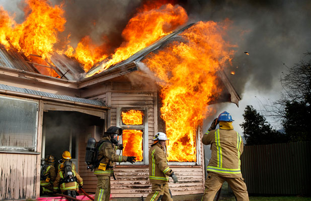 Flames take hold of the house with astonishing speed.
