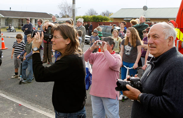Members of the public gather to watch the fire-fighters in action.
