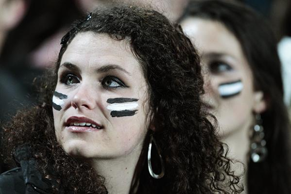 WAR PAINT: Rugby fans show their allegiance in the crowd.