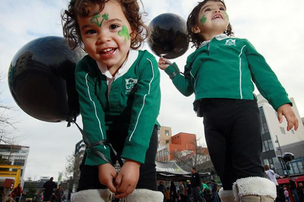 DUAL SUPPORTERS: Hamilton twins Aliesha and Holly Jamison, 2, had a foot in both camps with Irish jerseys teamed with black pants and balloons.
