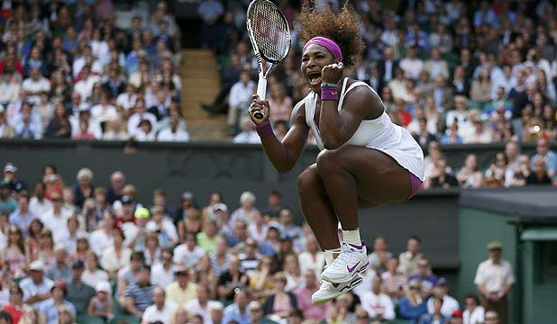 Serena Williams celebrates after defeating Zheng Jie in their women's singles tennis match at Wimbledon.