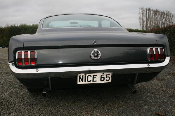 The plate on Manny Sim's 1965 Ford Mustang Fastback was a present from his daughter.