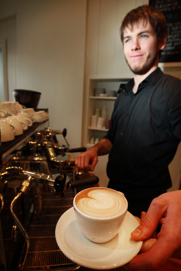 CUP OF JOE: River Street Kitchen barista Liam Austin serves up a coffee.
