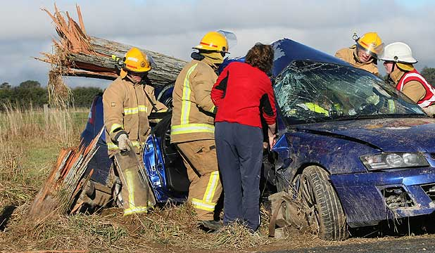Emergency personnel work to free the driver of this vehicle which crashed near Lochiel.