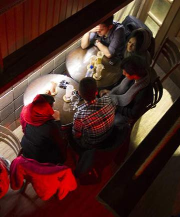 Iranian youths sit at a coffee shop in central Tehran.