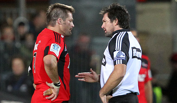 AH, BUT YOU DON'T BIN SIR RICHIE: Crusaders skipper Richie McCaw being  spoken to by ref Steve Walsh.
