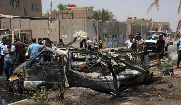Residents gather at the site of a car bomb attack in Sadr City, northeastern Baghdad.