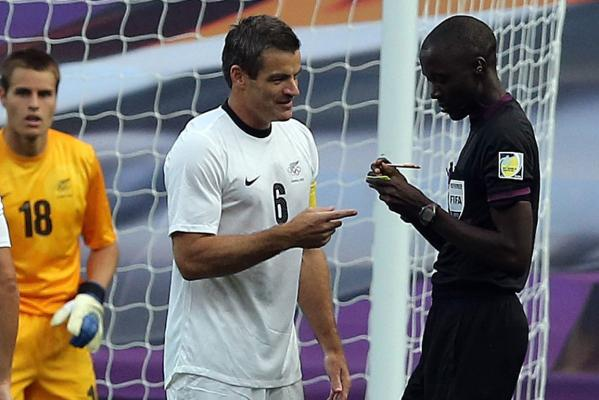 New Zealand's Ryan Nelsen questions referee Bakary Gassama during his team's loss  to Belarus at the London Olympics.