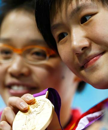 Chinese 16-year-old Ye Shiwen with her gold medal after winning the women's 400m individual medley in world record time at the London Olympics.