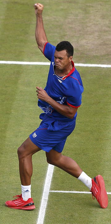 France's Jo-Wilfried Tsonga celebrates after defeating Canada's Milos Raonic at the London Olympics, winning the third set 25-23.
