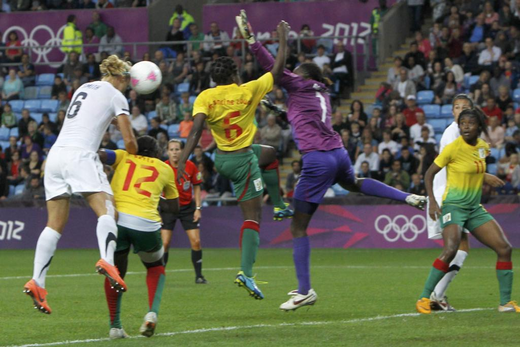 New Zealand's Rebecca Smith heads the ball to score a goal against Cameroon during their women's football match at the City of Coventry Stadium during the London Olympics.