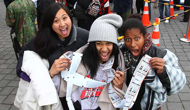 Chiefs fans celebrate after getting tickets for the Super Rugby final against the Sharks.
