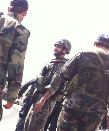 PRAISE FROM ASSAD: Forces loyal to Syria's President Bashar al-Assad are seen in Jubar near Damascus.