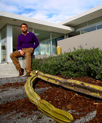 New Plymouth landscape designer Michael Mansvelt with the chopped-down cactus