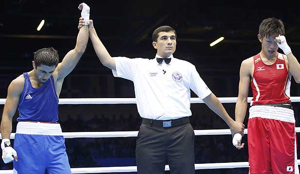 Azerbaijan's Magomed Abdulhamidov head slumps forward after defeating Japan's Satoshi Shimizu in their men's bantam (56kg) boxing match at the London Olympics.