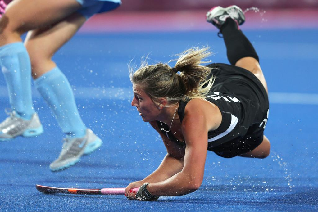 New Zealand's Gemma Flynn has a crack at goal during their women's hockey match against