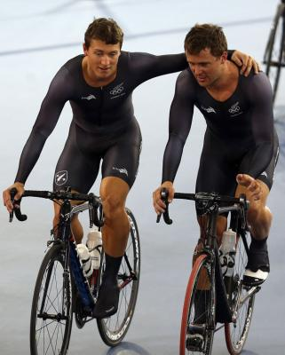 Ethan Mitchell and Simon van Velthooven console each other after the New Zealand men's team sprint was knocked out from the qualifying.
