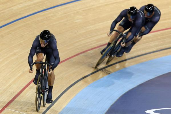 The New Zealand men's sprint team of Ethan Mitchell, Eddie Dawkins, and Simon van Velthooven in action at the London Olympics.