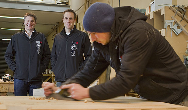 COMBINING CRAFTS: Andrew Davies, left, and Blair Quane, with cabinet-maker, Ben Roberts in their Bromley furniture factory.