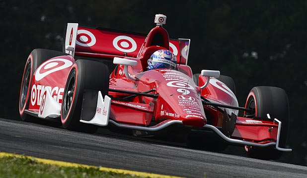New Zealand's Scott Dixon drives his Target Chip Ganassi Racing Dallara Honda during qualifying for the IZOD IndyCar Series Honda Indy 200 at the Mid Ohio Sports Car Course.
