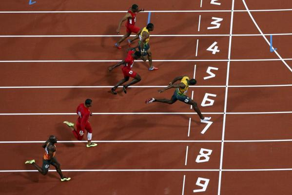 Jamaica's Usain Bolt crosses the finish line to win the men's 100m final during the London 2012 Olympic Games
