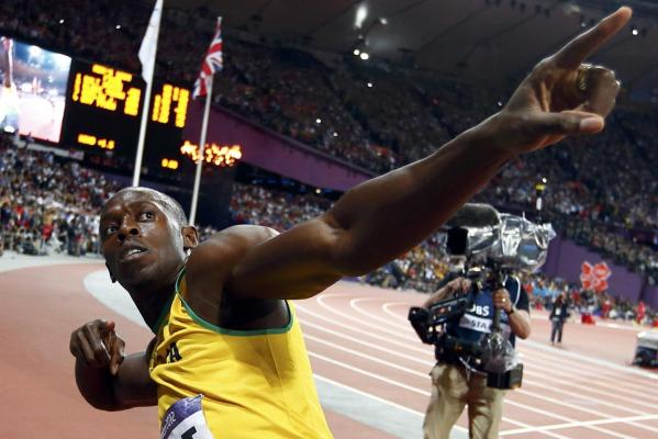Jamaica's Usain Bolt gestures as he celebrates after winning the men's 100m final during the London 2012 Olympic Games at the Olympic Stadium.