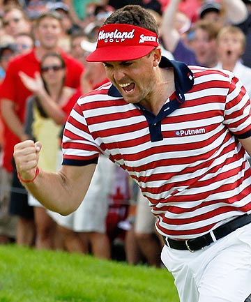 Keegan Bradley celebrates on the 18th green on his way to winning the World Golf Championship's-Bridgestone Invitational in Akron, Ohio.