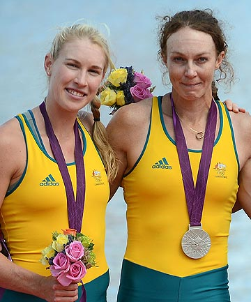 Australian silver medalists Kim Crow and Brooke Pratley with their medals after the women's double sculls rowing event at the 2012 London Olympics.
