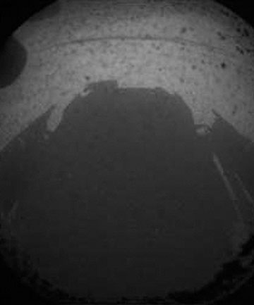 THE VIEW ON MARS: One of the first views from Nasa's Curiosity rover, taken from one of the rover's hazard-avoidance cameras.