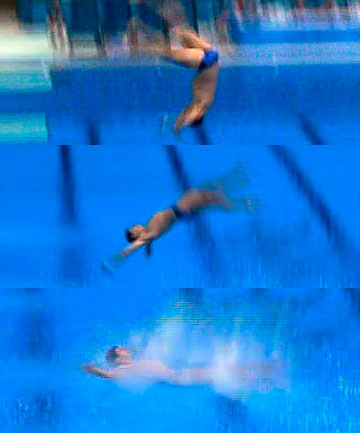 A series of screen shots show Stephan Feck's Olympic diving campaign ending in an ungainly backsplash.