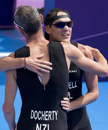 New Zealander's Bevan Docherty and Kris Gemmell hug each other after finishing 12th and 15th respectively in the men's triathlon at the London Olympics.