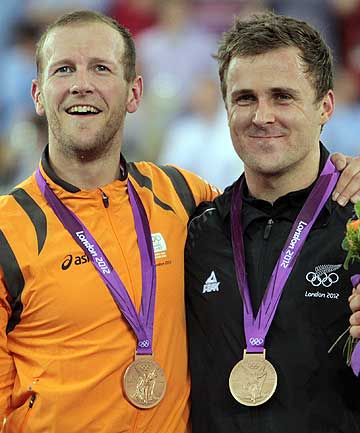 Simon van Velthooven (right) on the podium with fellow keirin bronze medallist Teun Mulder of the Netherlands after they finished third equal in the final at the London Olympics.