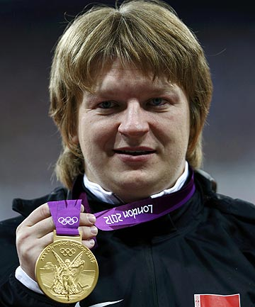 Belarus' Nadzeya Ostapchuk holds her gold medal after winning the women's shot put at the London 2012 Olympic Games.