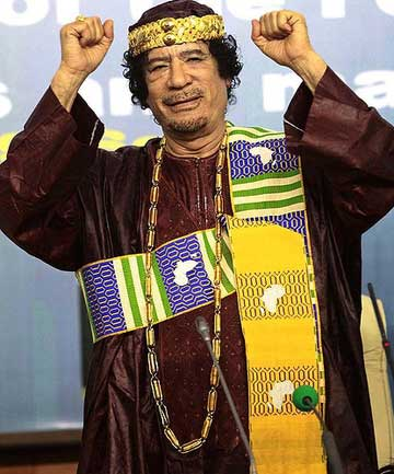 Muammar Gaddafi gestures as he attends the Second Forum for Kings, Sultans, Princes, Sheikhs and Mayors of Af
