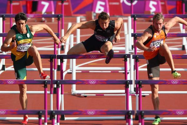 New Zealand's Brent Newdick competes in the 110m hurdles event of the de