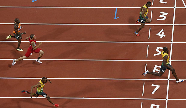 Jamaica's Usain Bolt wins the men's 200m final at the London Olympics to complete back-to-back sprint doubles.