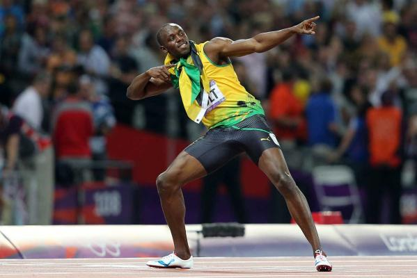 Jamaica's Usain Bolt strikes his traditional winning pose after winning the men's 200m final at the London 2012 Olympic Games.
