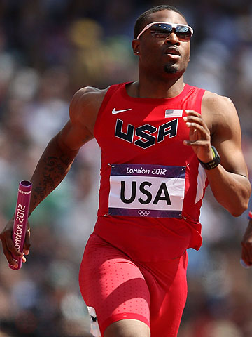 Manteo Mitchell of the United States runs in a men's 4x400m relay heat at the London Olympic Games.