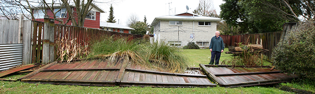 HIT: A mini-tornado destroyed a fence at Ian Vercoes' house on Micheal Ave in Dinsdale at approximately 12.30pm today.