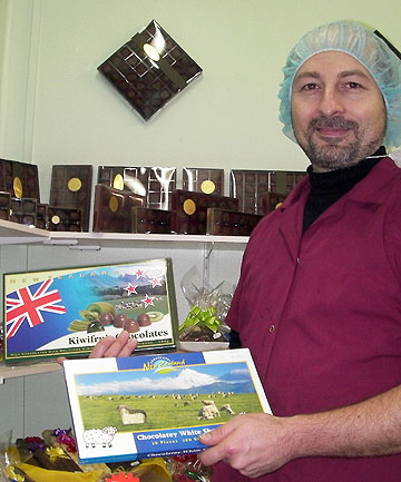 KIWI STYLE: Nyco Chocolates factory manager Paul Soncodi with boxes of the firm's distinctly New Zealand-themed chocolates.
