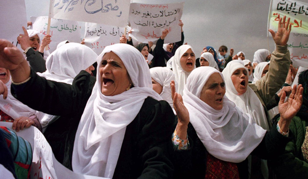 VEILED THREAT: Women  protest during a crackdown by the Palestinian Authority on Islamic fundamentalism. Is it right to stay silent in the face of fanaticism?