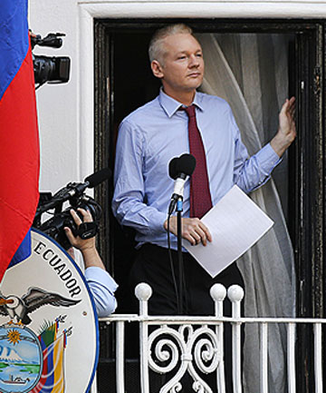 ASYLUM WON: Wikileaks founder Julian Assange prepares to speak from the balcony of Ecuador's embassy in London earlier this week.