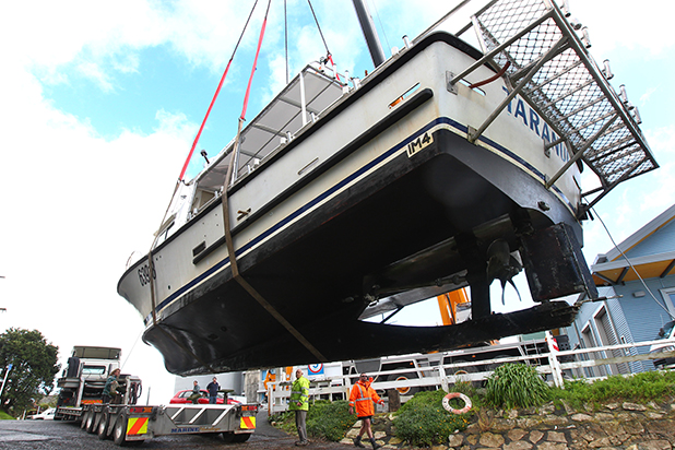 Megabite charters boat Taranui is lifted on the a transporter to begin a new life in Tairua.