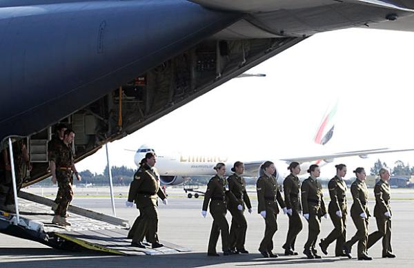 Troops leave plane