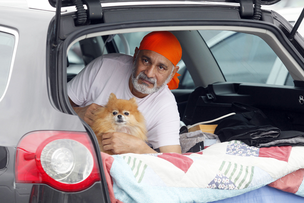 DEFIANT: Dr Suresh Vatsyayann while living in his car last year. He wants to continue  practising  ''for the good of my patients''