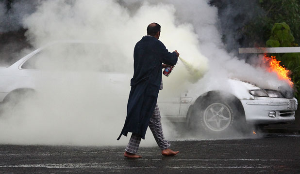 Clad in just his pyjamas and a dressing gown, Collin Pillay bound into action to battle a car fire in Carrington St, New Plymouth.