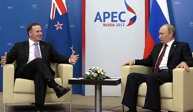 Russian President Vladimir Putin (right) speaks with New Zealand's Prime Minister John Key during their meeting at the Apec summit in Vladivostok.