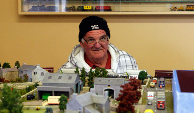 John Griffiths checks out the replica train set during the Blokes and Sheds Bus Tour.