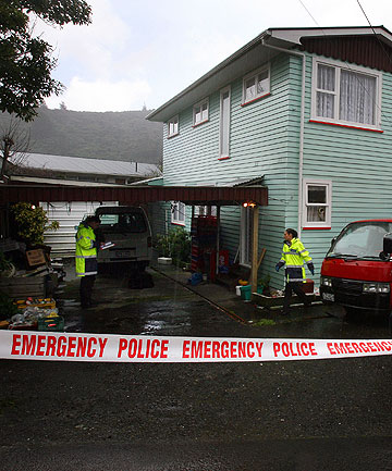 HOME INVASION: Police at the Cotters' Wainuiomata home after the attack by three men armed with baseball bats.